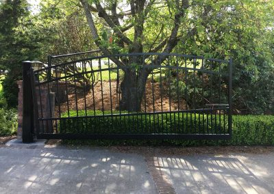 5' to 6' to 5', 3- Rail Regal Style Simple Arch Top Automated Driveway Gate. Gate is Hillside Style to Match Slope of Drive Way