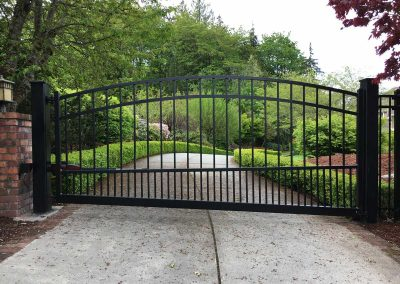5' to 6' to 5', 3- Rail Regal Style Simple Arch Top Single Swing Automatic Gate. Gate is Hillside Style to Match Slope of Drive Way