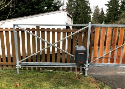 16'x6' automatic Cantilever gate with 1x6 cedar boards RSL 12 gate operator