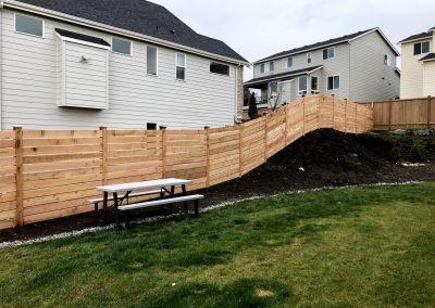 6' semi private horizontal cedar fence 1x6 #1 boards, contoured instal