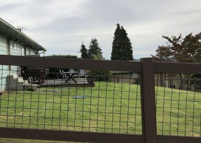 4' Hog Panel fence, NVP vinyl frame in the color Dark Sequoia frame, black inserts 2
