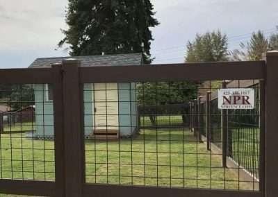 4' Hog Panel fence, NVP vinyl frame in the color Dark Sequoia frame, black inserts 3